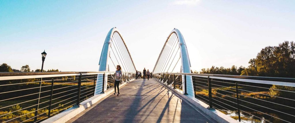 A silver bridge with people on it