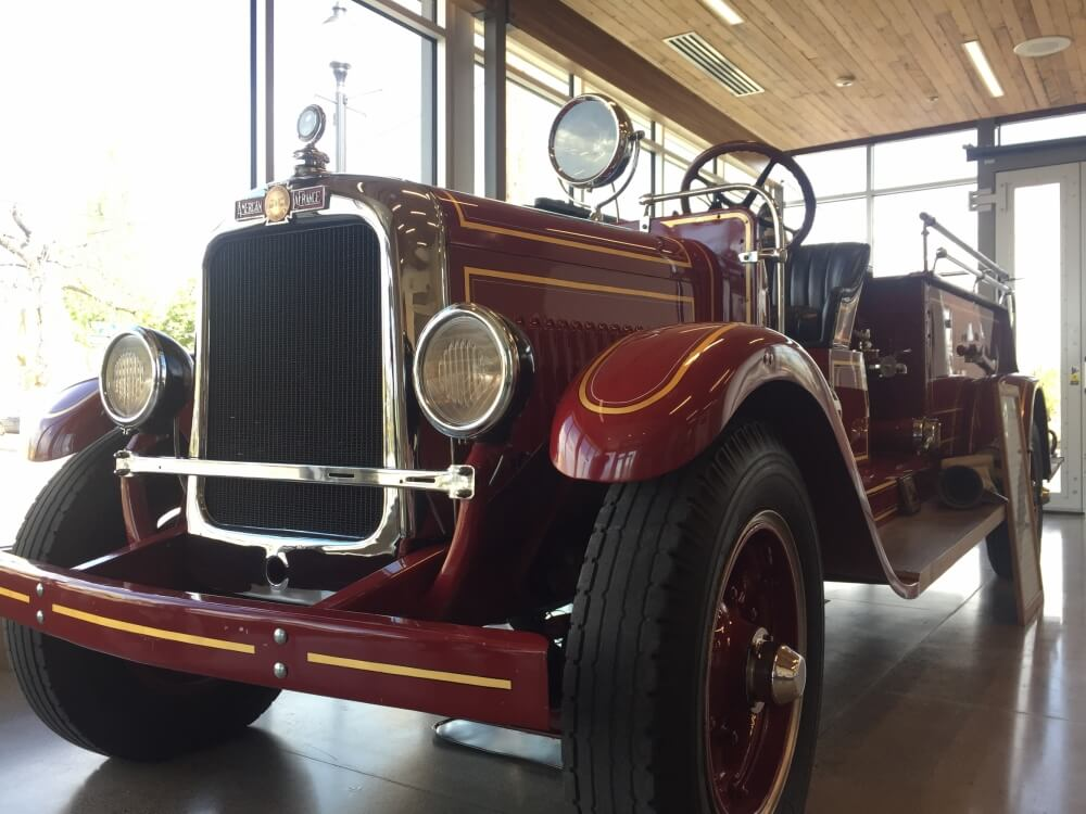 A vintage car in a museum