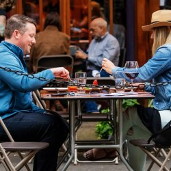 A man and woman dine outdoors in McMinnville