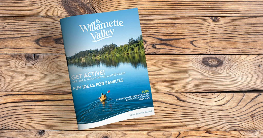 Willamette Valley visitor guide on a wood table