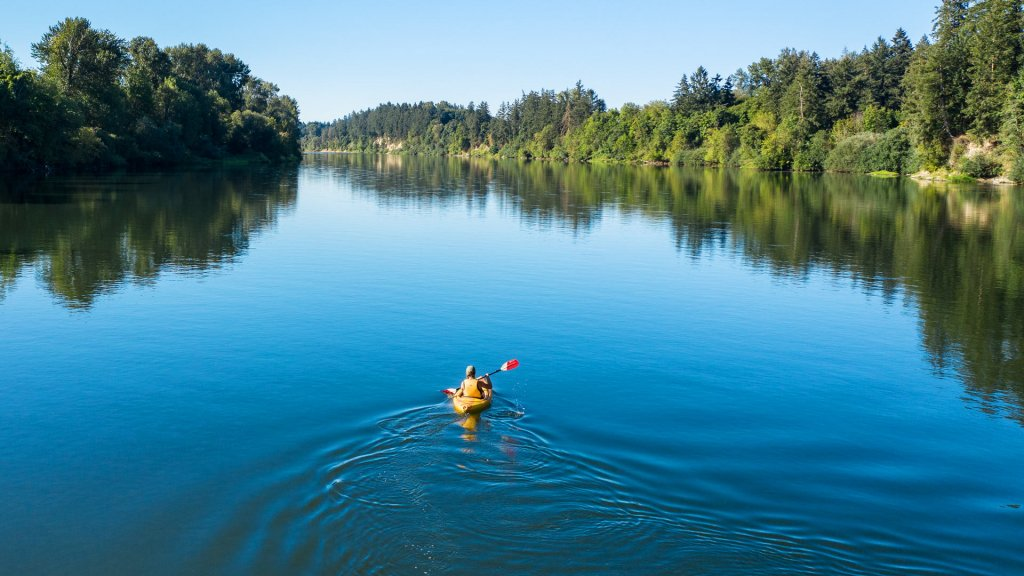 Person in a yellow kayak on the Willamette River