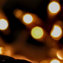 Extreme close up of a strand of lit Christmas tree lights