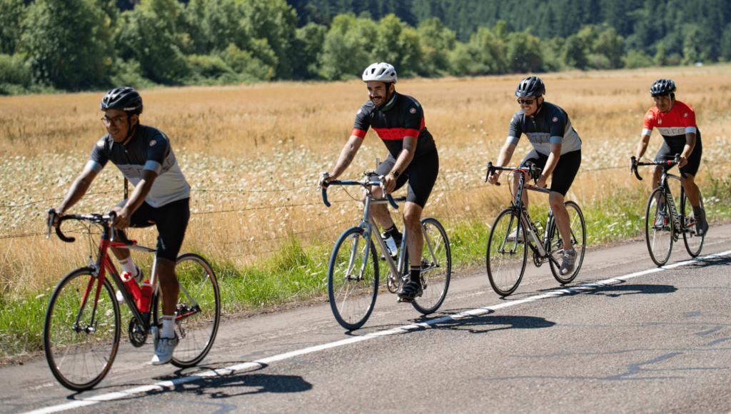 men cycling on a road