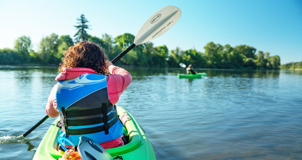 woman kayaking on a river
