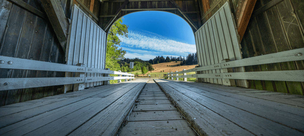 View of an Oregon landscape from inside covered bridge.